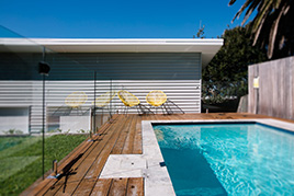 The poolside at  a property in Wollongong
